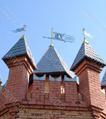 Castle, Towers with Feathers Upon Blue Sky