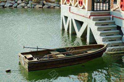 Rowboat beside marina stairs