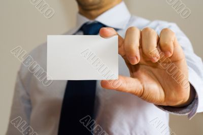 Business man holding a name card