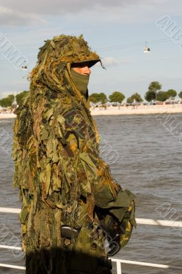 Military camouflaged solder.