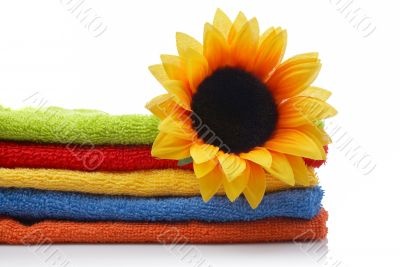 Artificial flower on towels