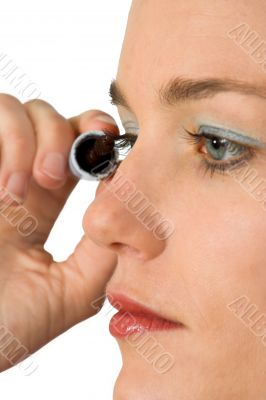 applying mascara over white
