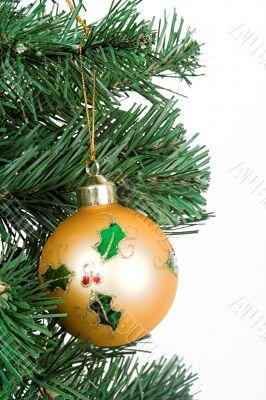 Yellow christmas ball hanging on a tree