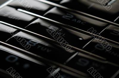 Close up shot of mobile keypad under dark