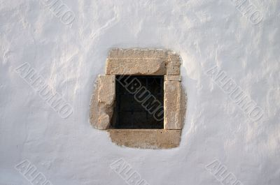 small window  in white lime wall
