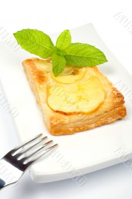 Fork and apple tart on a dish