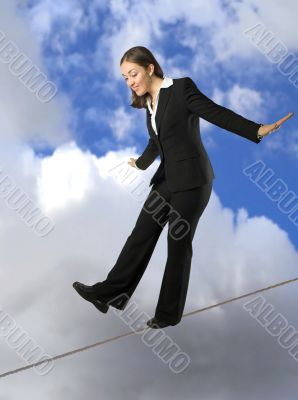 business woman balancing on rope
