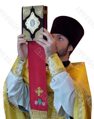 Orthodox priest rising ancient Holy Gospel