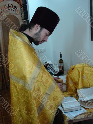 Orthodox priest prepares Sacred Participle foods
