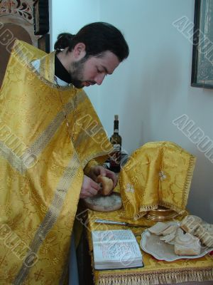Orthodox priest prepares Sacred Participle foods