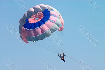 man flying on parachute