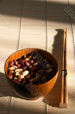 Pannikin with peanut on the bamboo mat