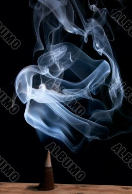 incense cone with smoke
