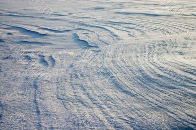 Erosion on the snow plain