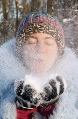 Girl blowing the snow