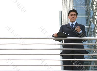 business man dialling on mobile