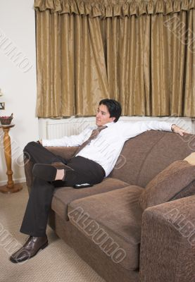 business man on a sofa relaxing