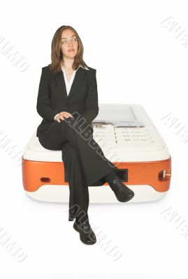 business communications - woman sitting on mobile