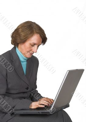 Business woman browsing on laptop