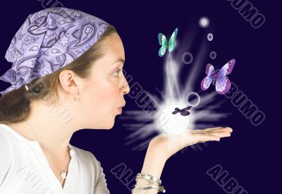 Beautiful girl blowing butterflies - mind reader