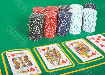 casino tokens and cards showing a royal flush