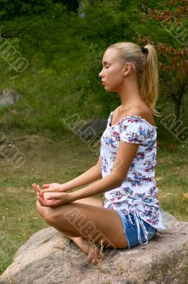 pretty blonde girl meditating