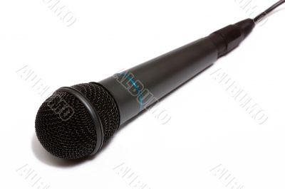 Grey microphone isolated on white.