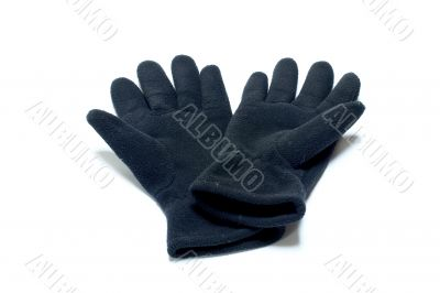 Woolen gloves against white background
