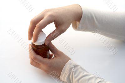 Opening a medicine bottle
