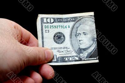 Man holding a ten dollar bill