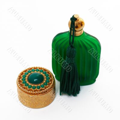 Antique gold box and green bottle