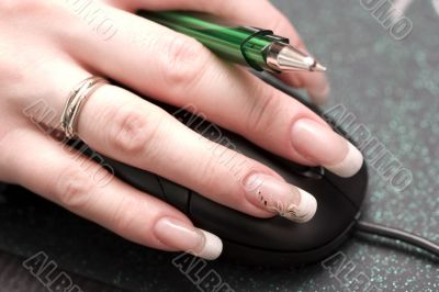 females finger with beauty nails over mouse