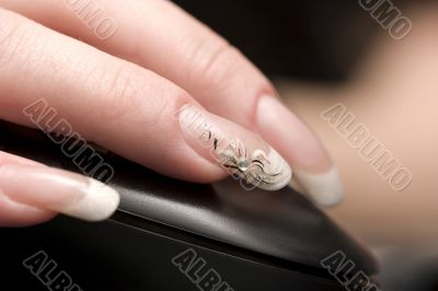 Beauty nails, fingers over computer mouse