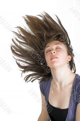 beautiful fashionable woman with moving hair