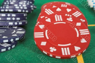 casino tokens in different colours