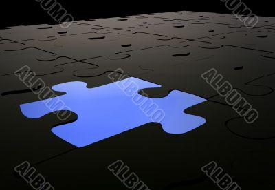 blue puzzle piece amongst black pieces
