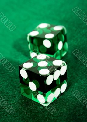 green dices over felt