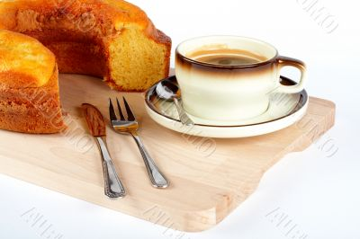 sponge cake with the cup of coffee and spoon