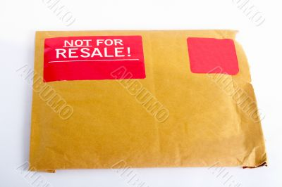 Envelope with red sticker: Not for resale