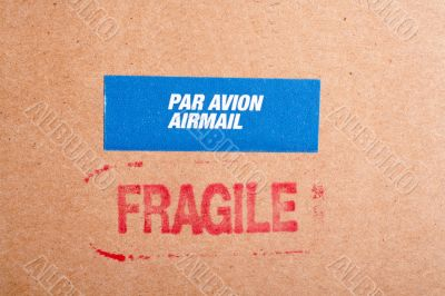 Fragile on cardboard box,  and sticker