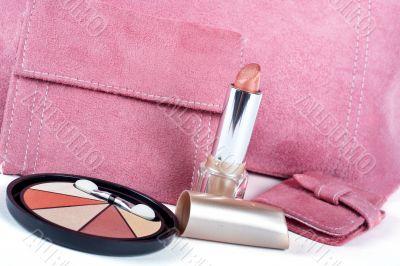 lipstick and Assortment of pink handbags