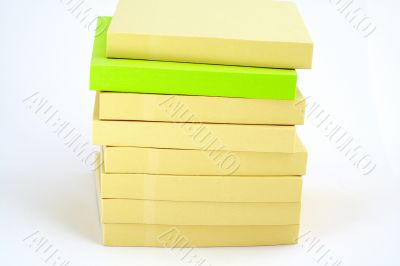 Yellow and green Blank Post-it papers stack