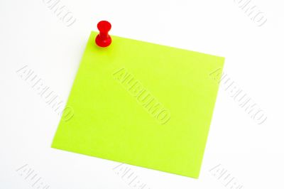 Isolated green paper with red pushnail