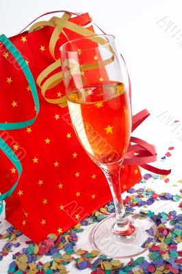 Champagne glass with red shopping bag