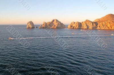 fishing Boats Past Rocks