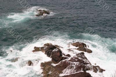 Surf Over Rocks