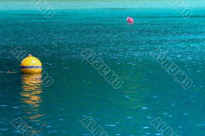 yellow buoy on turquoise sea