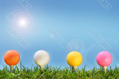 Colored golf balls in the grass