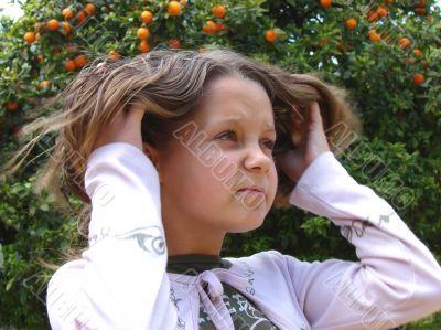 The girl correcting hair