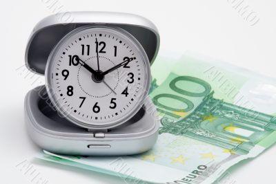 Clock and money (euros)